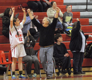 Cony unified basketball coach Paul Vachon celebrates after a 3-pointer during a game against Winslow on Monday in Augusta.