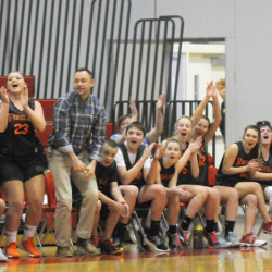 The Winslow High School unified basketball bench erupts after a basket during a game against Cony on Monday in Augusta.