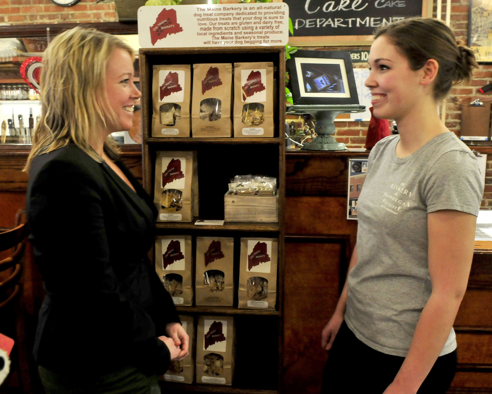 Maine Barkery owner Amanda Clark, right, speaks with Kristina Cannon, executive director of Main Street Skowhegan, who offered congratulations to Clark for winning a local Entrepreneur Challenge worth $20,000.