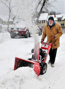 Al Roderique, on Ticonic Street in Waterville, uses his snow blower on the few inches of snow that fell Tuesday.