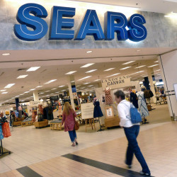 "In this May 14, 2012 file photo, shoppers walk into Sears in Peabody, Mass. After a ""challenging"" holiday shopping season, Sears is accelerating the closing of some of its stores."