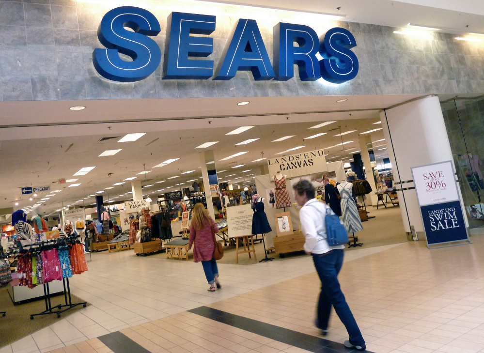 """In this May 14, 2012 file photo, shoppers walk into Sears in Peabody, Mass. After a """"challenging"""" holiday shopping season, Sears is accelerating the closing of some of its stores."""