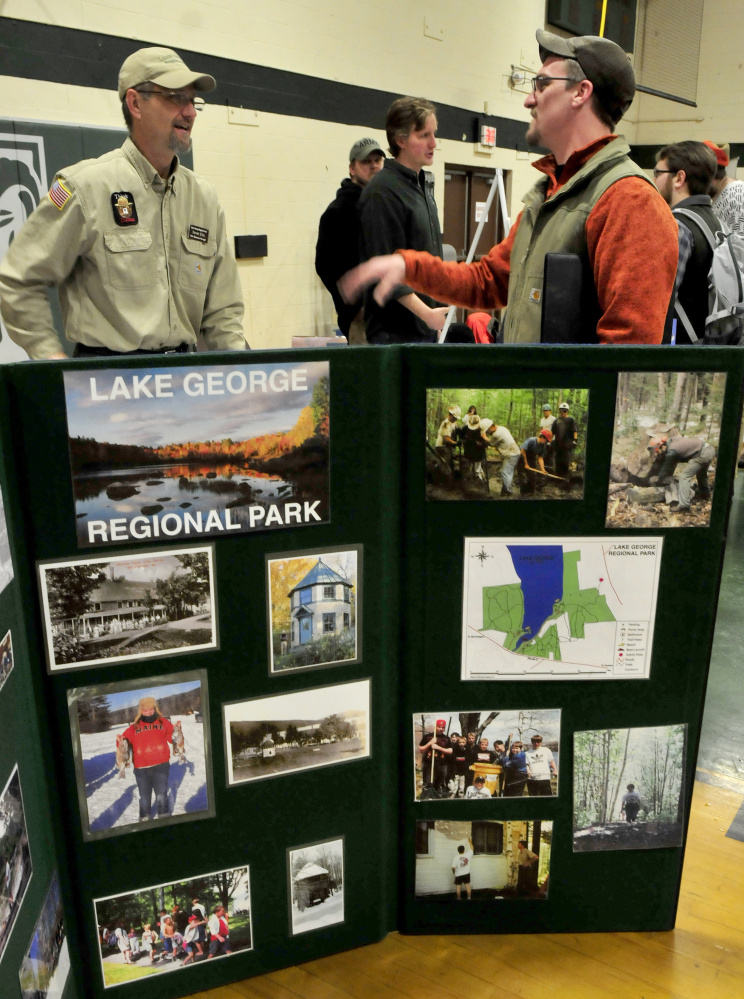 Derek Ellis, left, a park ranger at Lake George Regional Park in Skowhegan, speaks about his work to Unity College alumnus Dave Hammond during a well-attended annual Environmental Jobs Fair on Tuesday.