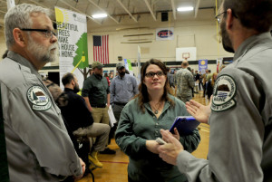 Staff photo by David Leaming Unity College student Shannon Johnson listens to park managers Fritz Appleby, left, and Matt McQuire of the Maine Department of Agriculture, Conservation and Forestry about employment opportunities during a career fair at the college on Tuesday.