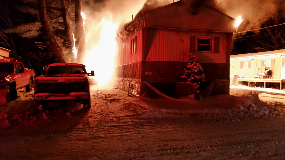 Fire destroyed a mobile home early Saturday morning on Webb Road in Oakland. Two people were taken to the Portland hospital with second-degree burns on their face, arms, legs and back.