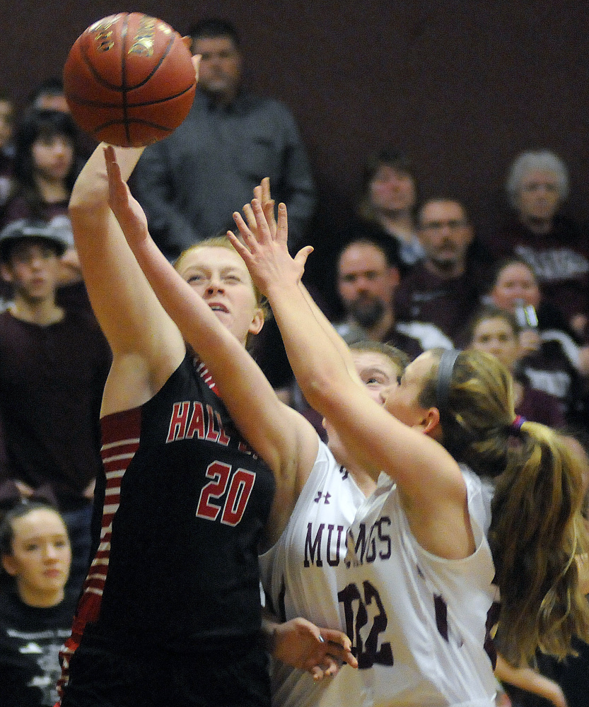 Monmouth Academy's Sidney Wilson, right, and Abbey Allen block a shot from Hall-Dale's Sabrina Freeman during a Class C South prelim game Tuesday in Monmouth.