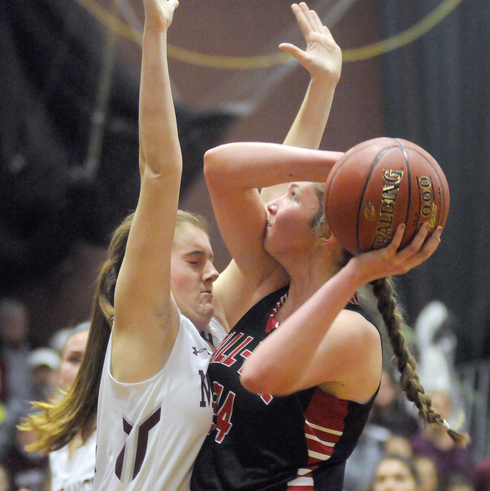 Monmouth's Abbey Allen blocks defends Hall-Dale's Kayla Johnson during a Class C South prelim game Tuesday in Monmouth.