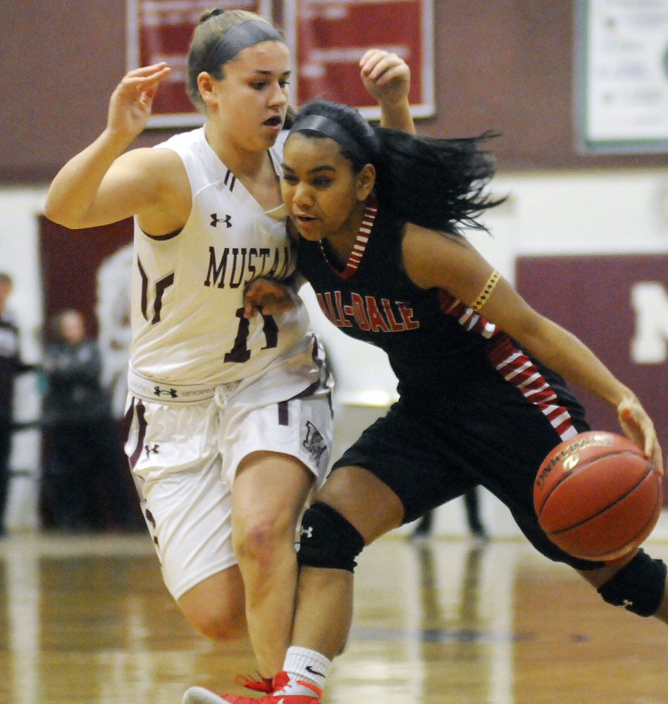 Monmouth's Hannah Anderson, left, defends Hall-Dale's Dani Sweet during a Class C South prelim game Tuesday in Monmouth.