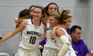 Members of the Waterville girls basketball team celebrate after they ousted Oceanside in a Class A North prelim game Tuesday night.