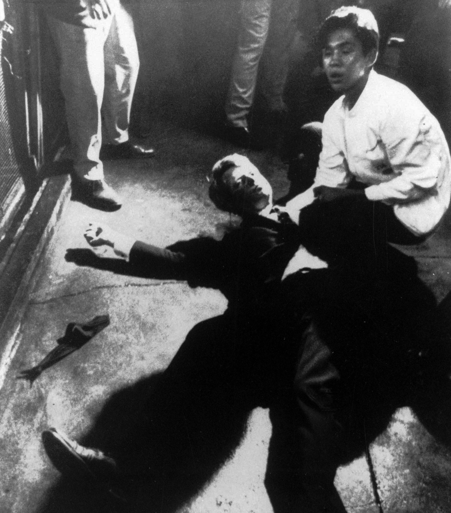 In this June 5, 1968 file photo, Sen. Robert F. Kennedy awaits medical assistance as he lies on the floor of the Ambassador hotel in Los Angeles moments after he was shot.