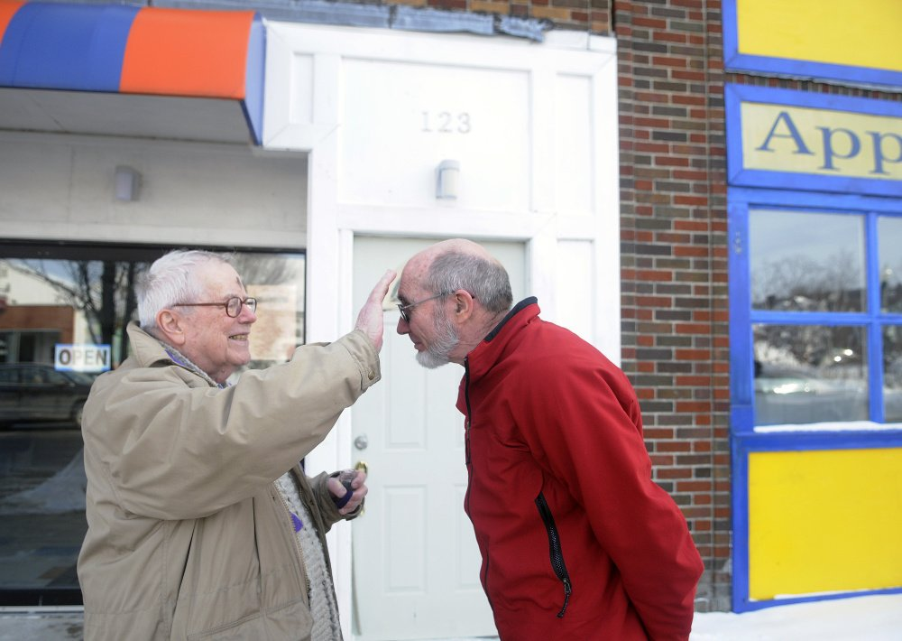 The Rev. James Gill applies ashes to Bill Nave on Main Street in Winthrop on Ash Wednesday.