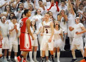 Gardiner Area High School's fans react to a shot by Isaiah Magee (3) against Cony during a Class A North preliminary round game Wednesday in Gardiner.
