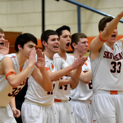 Players on the Skowhegan Area High School bench celebrate a three-pointer against Waterville Senior High School in Skowhegan on Wednesday.