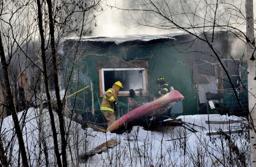 Firefighters from Anson, Madison and Skowhegan battle a fire that destroyed a home on Horseback Road in Anson Thursday morning.