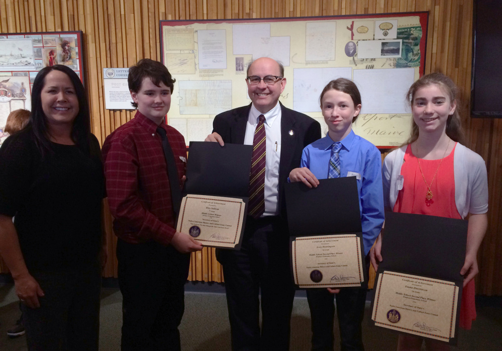 Contributed photo From left are Mali Dana, representing the Penobscot Nation and one of the judges; Riley Sullivan, first place winner; Secretary of State Matt Dunlap; and Avery Henningson and Emma Hutchinson, who tied for second.