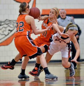 Winslow High School's Ciara LeClair, center, and Delaney Wood (22) collide with Skowhegan's Annie Cooke, right, during a game earlier this season. The Black Raiders open Class B North quarterfinal play Saturday morning at 10:35 against Ellsworth at the Cross Insurance Center in Bangor.