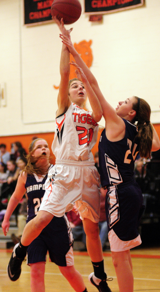 Gardiner's Mary Toman shoots over Hampden's Sophia Narofsky during a game last month in Gardiner. The No. 3 Tigers play No. 6 Mt. Blue in a Class A North quarterfinal game Friday at 3:30 p.m. in the Augusta Civic Center.