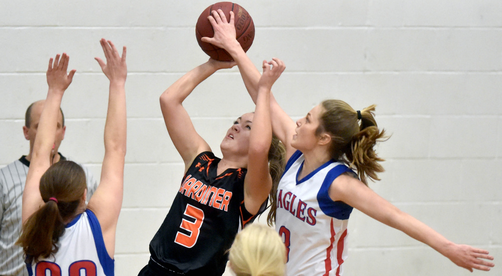Messalonskee's Sophie Holmes, right, blocks a shot by Gardner's Mikayla Bourassa during a Kennebec Valley Athletic Conference Class A game last month in Oakland. The Eagles and Tigers open Class A North quarterfinal round play Friday at the Augusta Civic Center.