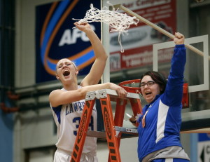 Lawrence forward Nia Irving, left, had some fun cutting down the nets after the Bulldogs sank Thornton Academy in the Class A state title game last season. Irving and the Bulldogs open their title defense Friday night against Skowhegan.