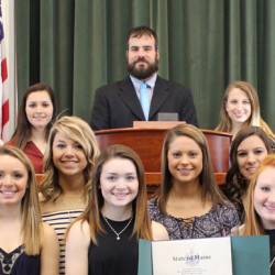 In front, from left, is Alyssa Salley, Maliea Kelso, Rylie Mullin, Sadie Ross, Taylor Holmes. Middle row, from left, are: Gabby Bushey, Lizzie York, Haley Carter, Cassidy Clement, Brooke Michonski, Julia Steeves, Leah Kruse and Patricia Ward. In back, from left, is Courtney Ferrara, Kealey Bowman, Kelsey Thaller, Haley Thebarge, House Majority Leader Jeff McCabe, Abby Stevens, Alexis Vashon, Elizabeth Sirois, Mariah Dunbarand Wylie Bedard.