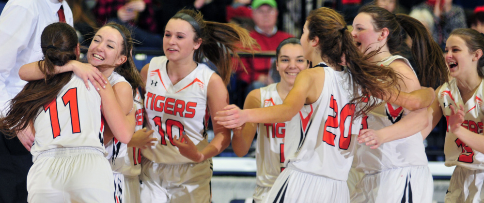 The Gardiner Tigers celebrate after beating Mt. Blue in a Class A North quarterfinal game at the Augusta Civic Center.