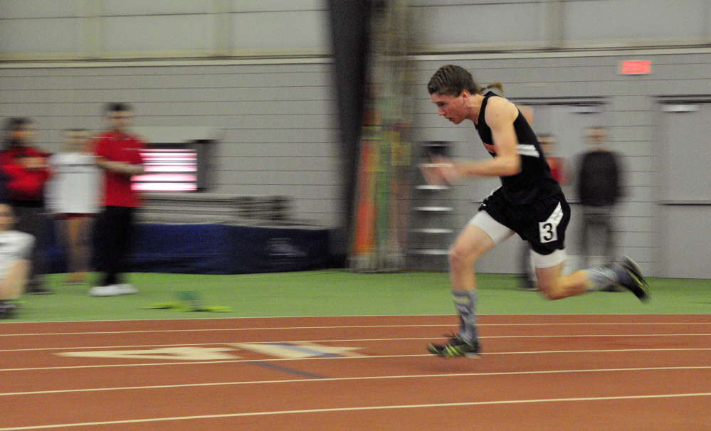Winslow's Ben Smith competes in the 200-meter sprint during the Kennebec Valley Athletic Conference Class B indoor track championships last Saturday at Bowdoin College in Brunswick.