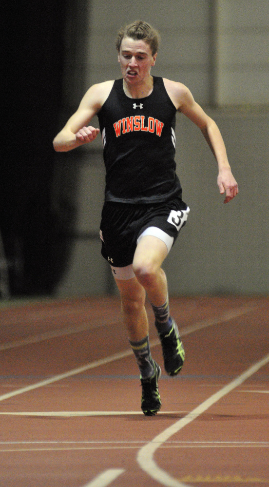 Winslow's Ben Smith pushes ahead in the 200-meter sprint during the Kennebec Valley Athletic Conference Class B indoor track championships last Saturday at Bowdoin College in Brunswick.