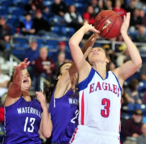 Waterville's Mackenzie St. Pierre, left, and Jordan Jabar go up for a rebound with Messalonskee's Sophie Holmes during a Class A North quarterfinal Friday at the Augusta Civic Center.