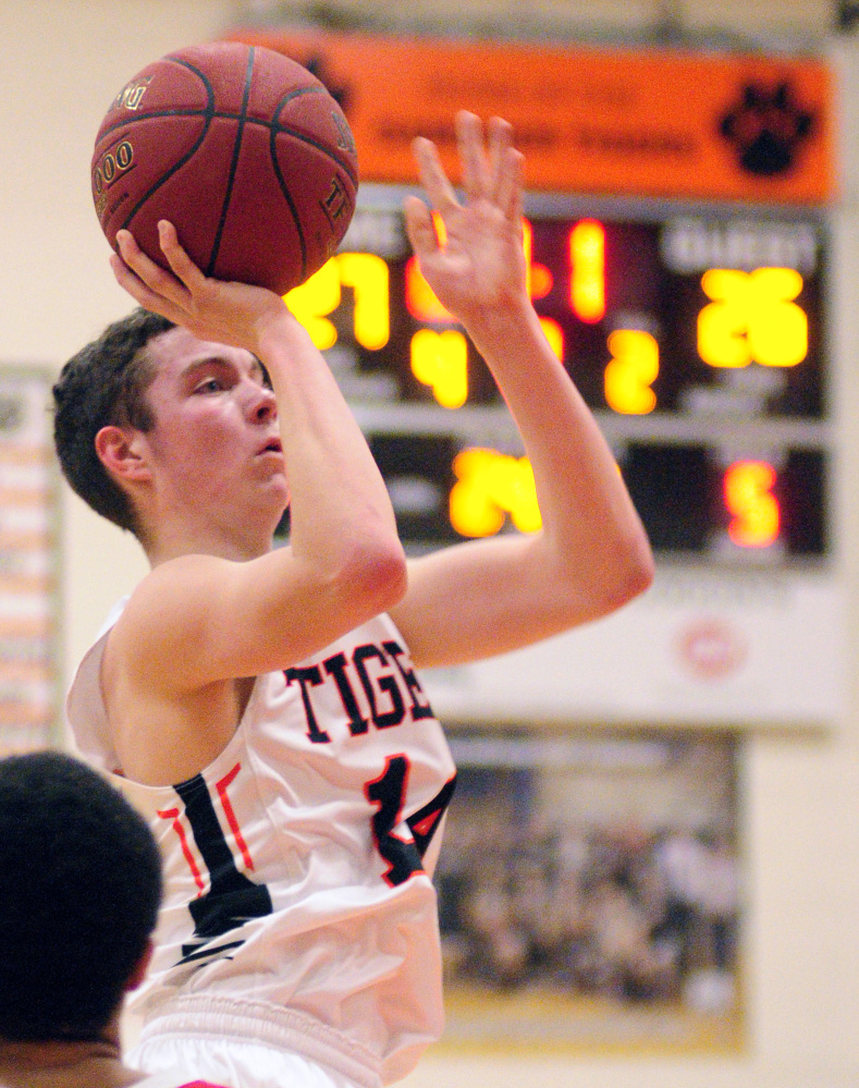 Staff file photo by Joe Phelan Gardiner's Brian Dunn shoots during a game against Cony earlier this season in Gardiner. The Tigers face No. 2 Brewer in a Class A North quarterfinal Saturday in Augusta.