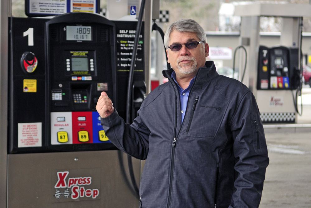 John Babb, president of J&S Oil, talks about converting the company's credit and debit card system to a chip system during an interview Wednesday at the company's Xpress Stop store in Manchester.