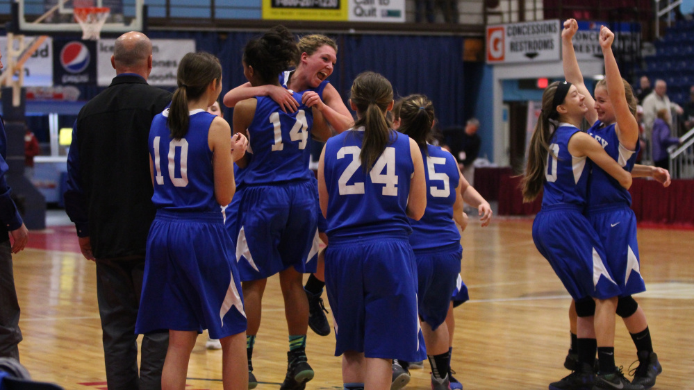 Members of the seventh-seeded Valley girls basketball team celebrate after they upset No. 2 Forest Hills 31-22 in a D South quarterfinal Saturday afternoon at the Augusta Civic Center.