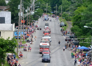 The annual Winslow Family 4th of July parade marches down Bay Street in Winslow last year. Organizers of the three-day celebration, which also includes bands and a fireworks show, say a higher bill from the Police Department might make it impossible to continue holding the event.