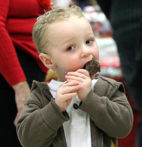 Eli Dulac, 2, of Clinton, takes a bite of a chocolate lollipop Saturday at the annual Fairfield Chocolate Festival. The event, held in the Fairfield Community Center, raised money for the Fairfield Council of Churches Emergency Heating Fund.
