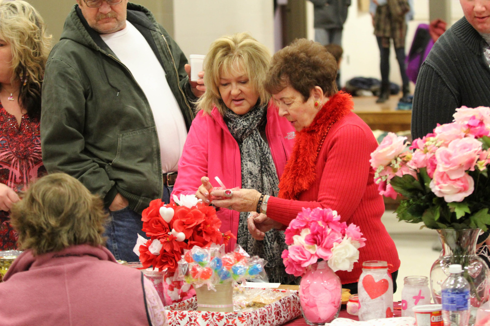 Linda Donahue, of Clinton, and her mother-in-law, Joanne Donahue, of Fairfield, pick out some treats Saturday at the annual Fairfield Chocolate Festival. The event, held in the Fairfield Community Center, raised money for the Fairfield Council of Churches Emergency Heating Fund.