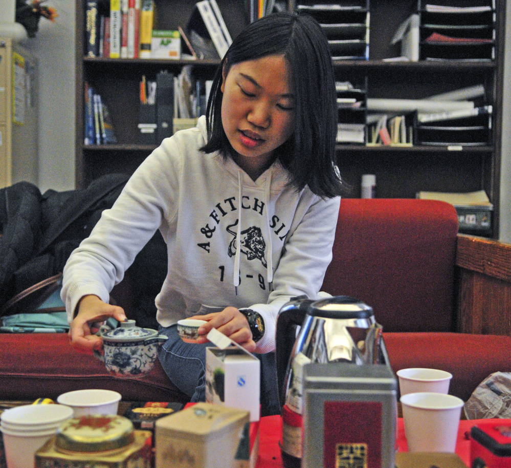 Chujun Chen pours tea Saturday during the International Festival at Kents Hill School in Readfield. Several kinds of tea and coffee were available for sampling at the event.