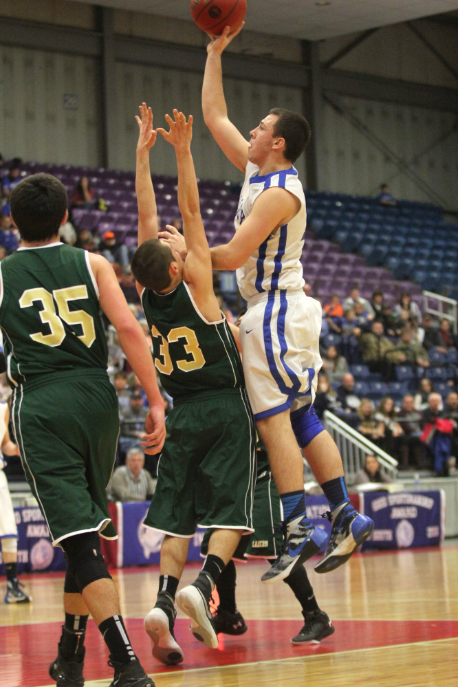 Valley's Collin Miller puts up a shot over Rangeley's Kyle LaRochelle during the first half of a Class D South quarterfinal Saturday at the Augusta Civic Center.