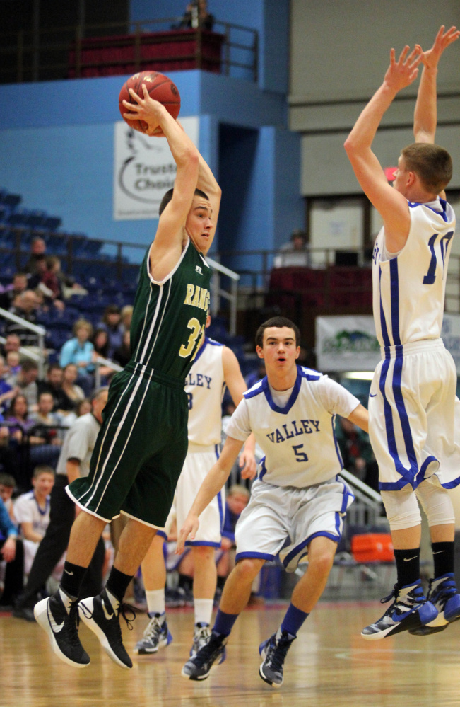 Rangeley's Kyle LaRochelle tries to pass the ball as Valley's Luke Malloy, left, applies some pressure during the first half of a Class D South quarterfinal at the Augusta Civic Center on Saturday.