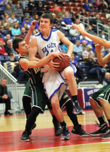 Valley's Austin Cates gets fouled by Rangeley's Carl Trafton on a drive to the basket during the first half of a Class D South quarterfinal Saturday at the Augusta Civic Center. Valley won 62-33.
