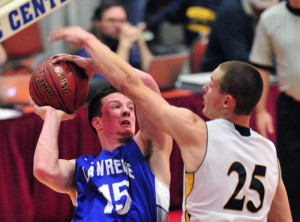 Lawrence's Seth Powers tries to shoot as Medomak's Cameron Allaire defends during a Class A North quarterfinal Saturday at the Augusta Civic Center.