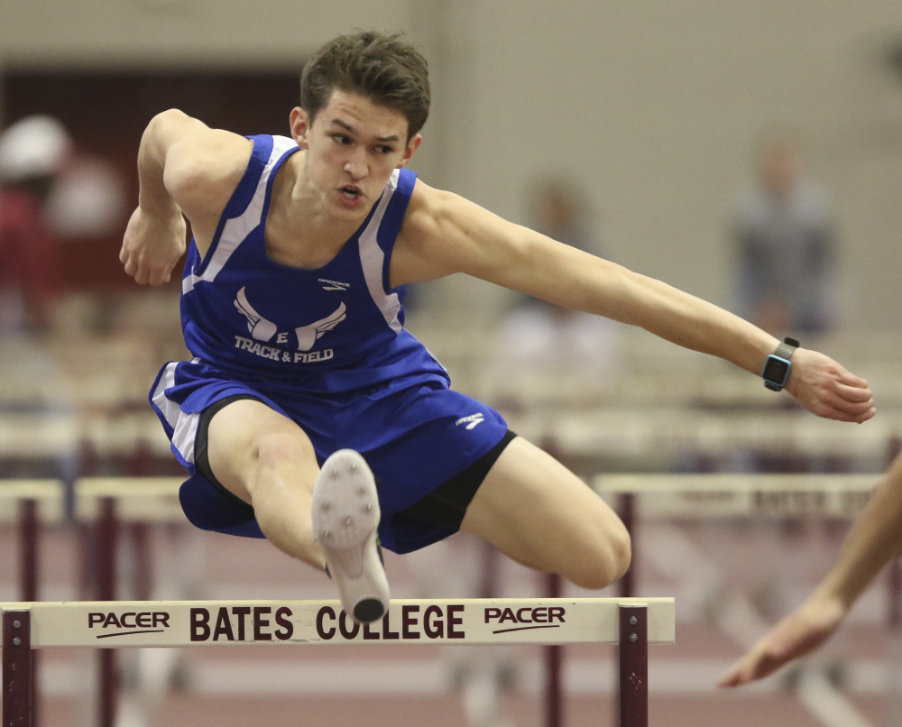 Erskine's Ethan Dodge clears the final hurdle of the 55-meter hurdles at the Class B state indoor track and field championship Saturday at Bates College.