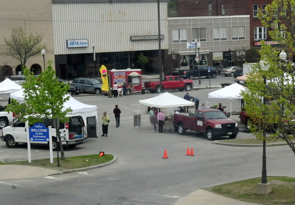 Vendors set up for the farmers market in The Concourse in Waterville, a location where Colby College wants to build a student dormitory as part of downtown revitalization efforts.