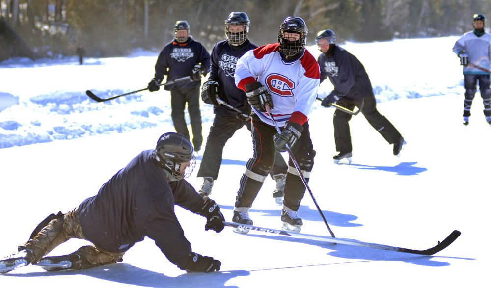 Some old-fashioned hockey breaks out Sunday during the Maine Pond Hockey Classic at the Snow Pond Center for the Arts in Sidney.