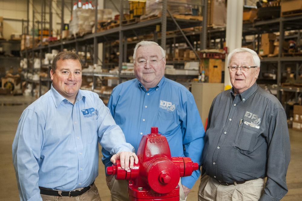 President Steven Prescott, left, Chief Executive Officer Peter Prescott and Chief Operating Office Stanley McCurdy on Thursday at E.J. Prescott headquarters in Gardiner.
