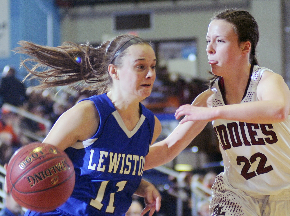 Lewiston's Kristina Blais, left, dribbles around Edward Little's Piper Norcross during a Class AA South girls semifinal Tuesday at the Augusta Civic Center. Norcross scored 13 points to help the Red Eddies cruise to a 58-23 victory.