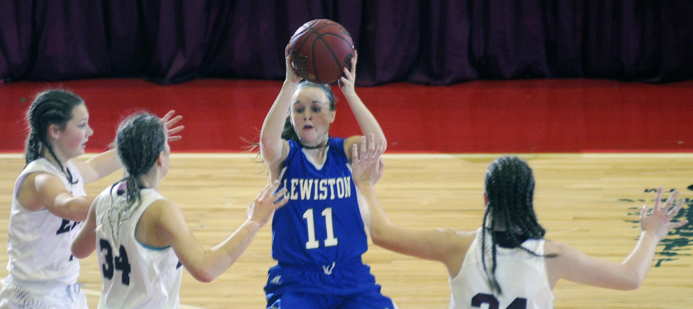 Lewiston's Kristina Blais looks for an open teammate as a swarming Edward Little defense converges during an AA South girls semifinal game Tuesday at the Augusta Civic Center.