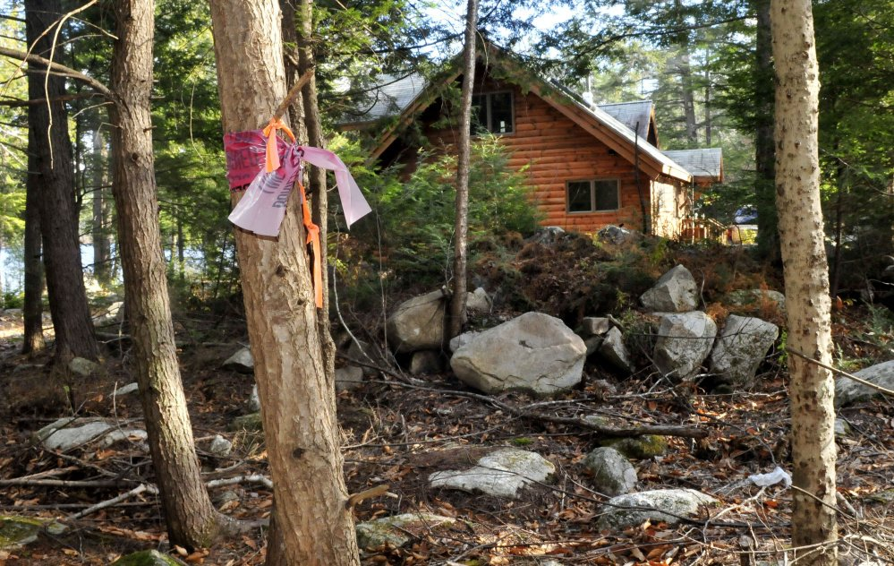 A ribbon marks the boundary of a proposed summer camp and the Jorgenson property on Long Pond in Rome. Doris and Eric Jorgenson, as well as other nearby residents, have filed an appeal of the building permit for the camp approved by the Planning Board.
