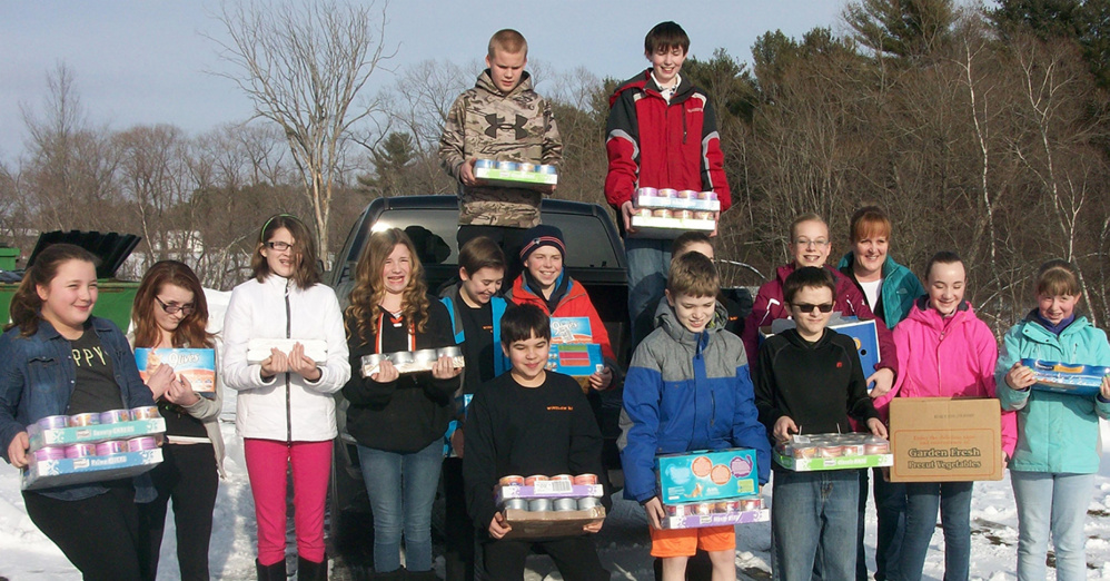 In front, from left, are Owen Schuchardt, Lucas Williams and Ryan Wahl. Second row, from left, are Bina Harriet, Jessica Lange, Danica Soule, Marissa Elwell, Connor Veilleux, Ethan Loubier, Lexxis Sirois, Anna Lakey, Irene Dineen (teacher and fundraiser coordinator), Megan Huessers and Kaitlin Morrison. On truck, from left, are Landen Gillis and Nick Weiss.