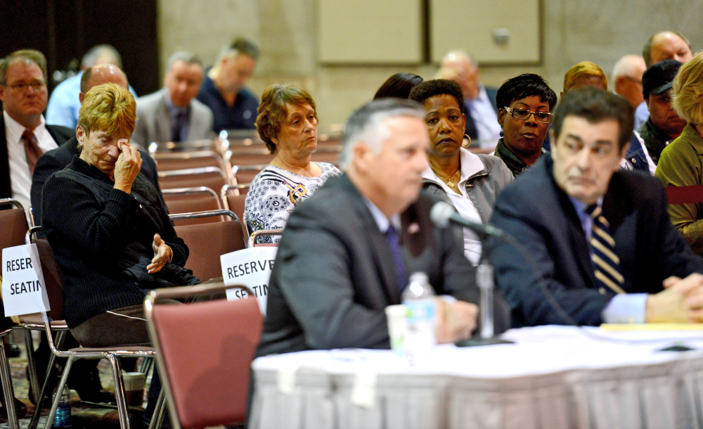 Retired Rear Admiral Philip H. Greene, Jr, President and CEO of TOTE Services, Inc., front center, sits at a hearing investigating the sinking of the El Faro ship as family members of the crew look on, in Jacksonville, Fla., Wednesday.