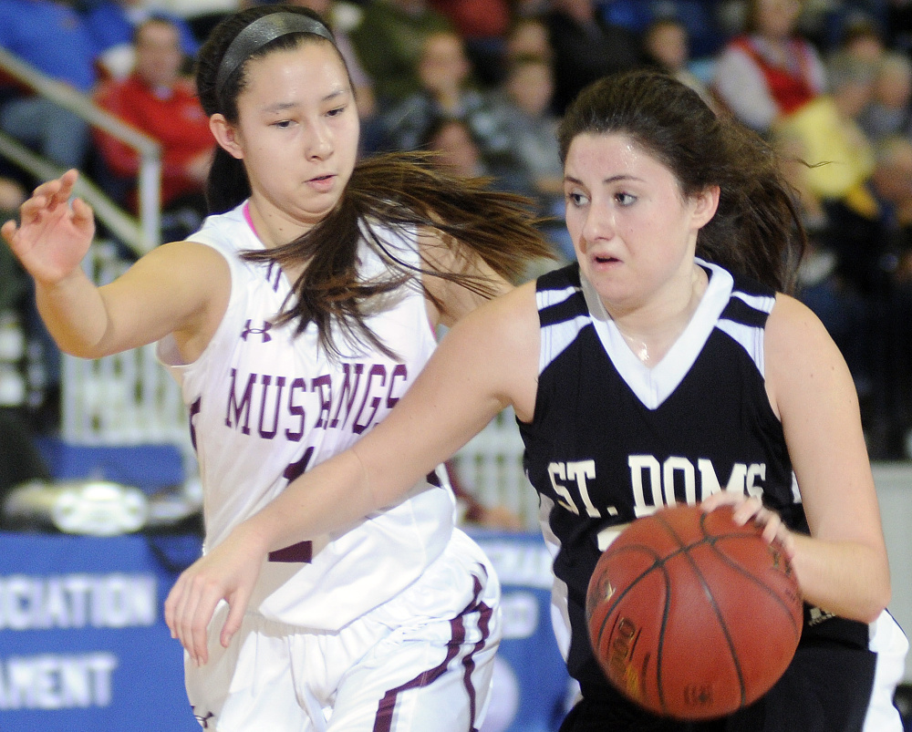 Monmouth Academy's Tia Day guards St. Dominic Academy's Allie Veinote during a Class C South quarterfinal game on Monday in Augusta.