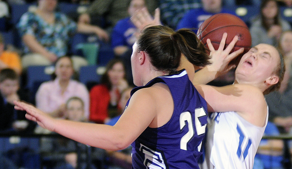 Lawrence's Nia Irvng, right, grabs a rebound around Hampden's Braylee Wildman during a Class A North semifinal Wednesday night at the Augusta Civic Center.